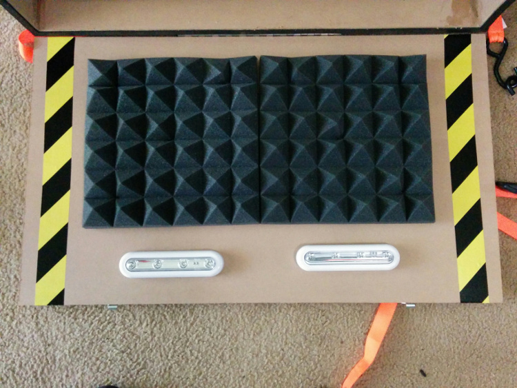 Acoustic foam and LED lights attached to the front panel